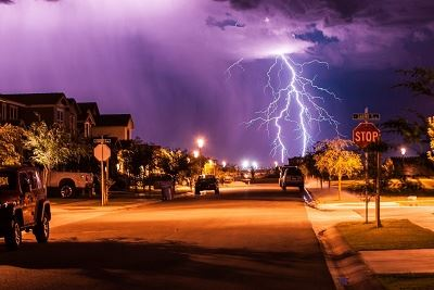 Lightning Caught on Camera, Striking down in the Distance near a Neighborhood