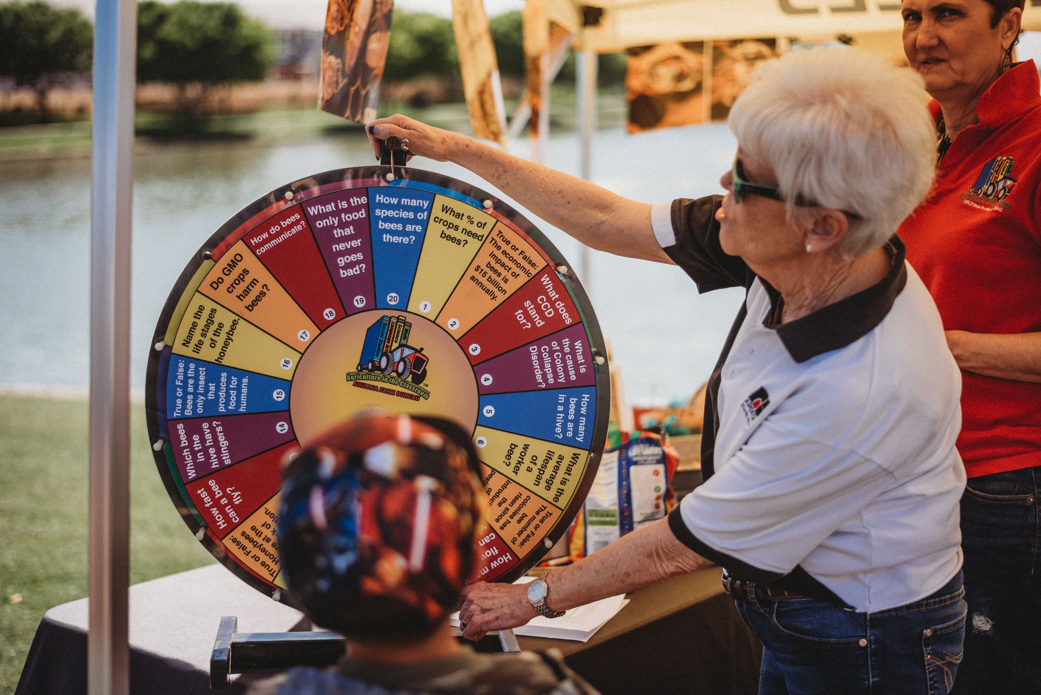 Older Woman Spinning a Trivia Wheel