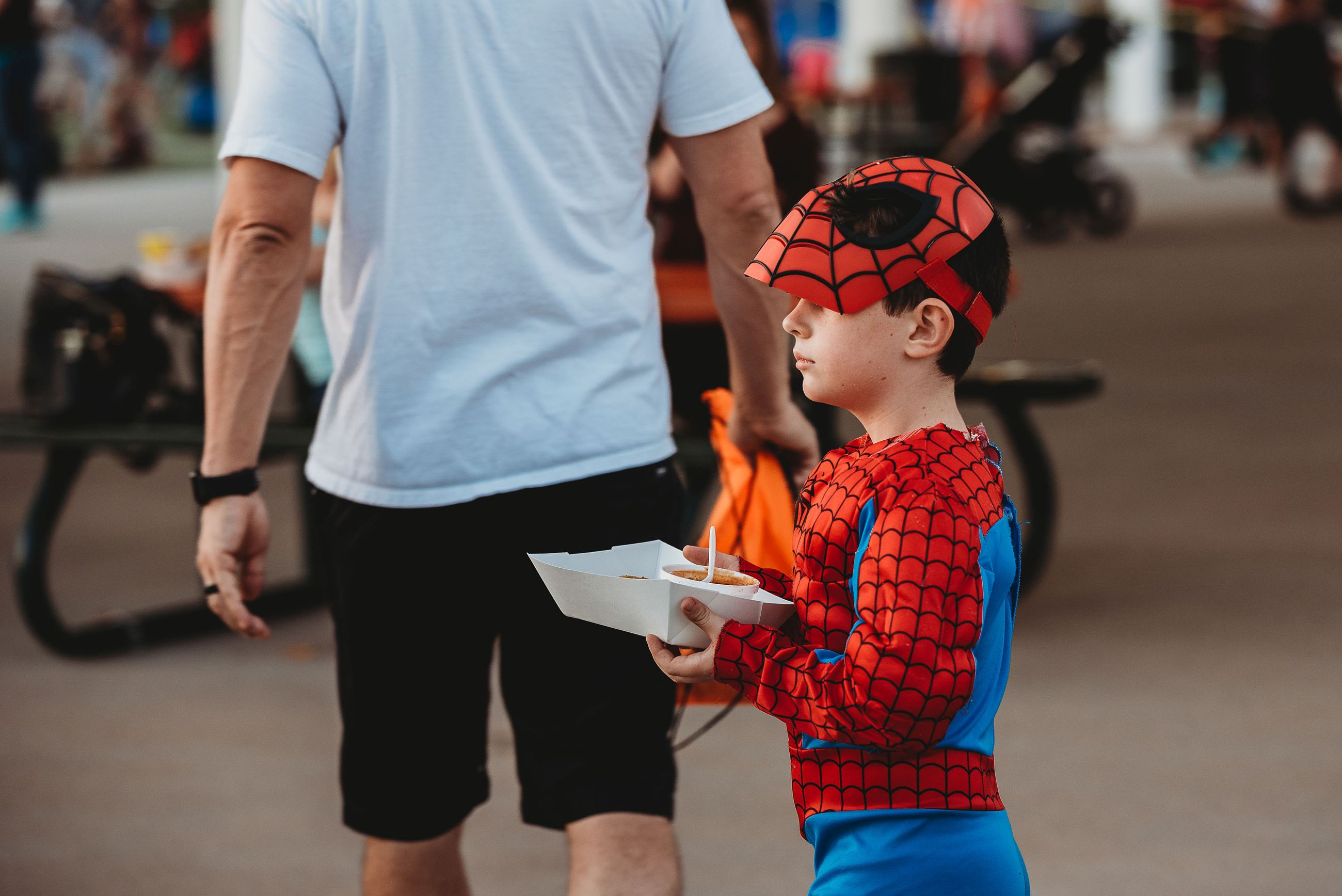 Boy Dressed as Spiderman Holding a Concessions Boat