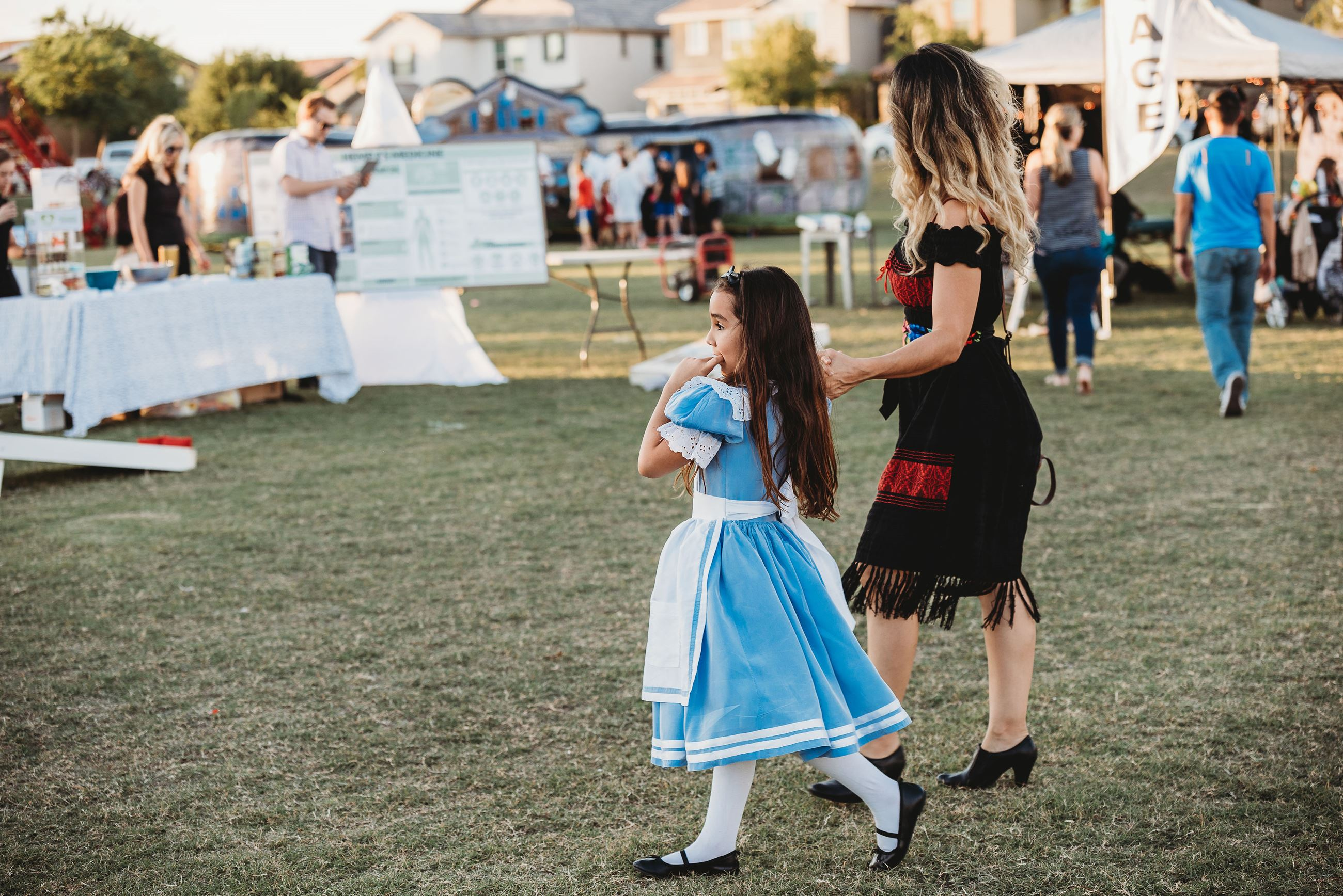 Little Girl Dressed as Alice from Alice in Wonderland with Her Mother